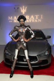 Model pose in front of the new Maserati Ghibli on display in the Maserati of Manhattan Showroom