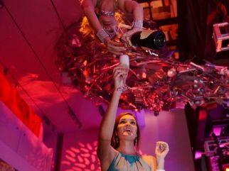 Champagne purring Aerialist-Aerial Bartender -human champagne chandelier