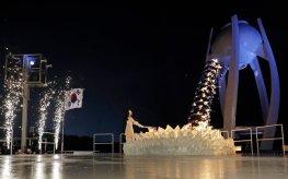 South Korean Olympic figure skating champion Yuna Kim kindles the Olympic flame. David J. Phillip/AP