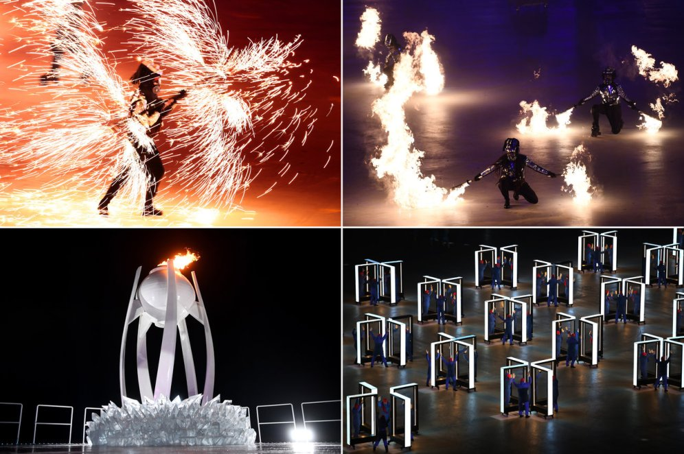 Fire displays light up the opening ceremony before the Olympic cauldron (bottom left) is kindled. Lars Baron; Jonathan Nackstrand; Frank Fife;Sean M. Haffey/Getty Images
