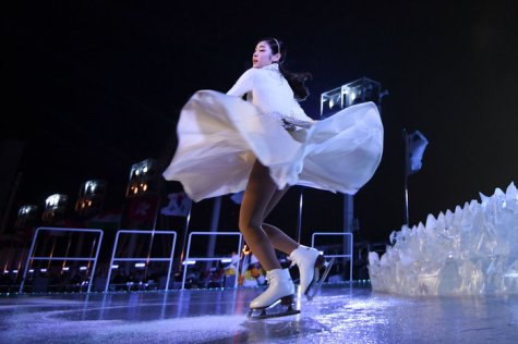 South Korean figure skater Yuna Kim performs before lighting the Olympic cauldron. Franck Fife/AFP/Getty Images